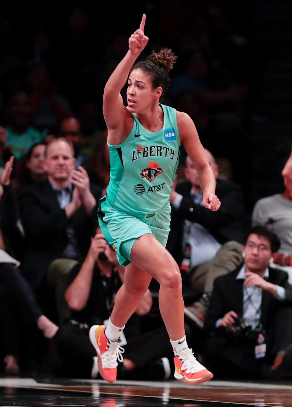 New York Liberty guard Kia Nurse celebrates after hitting a 3-pointer in a 2019 exhibition game.