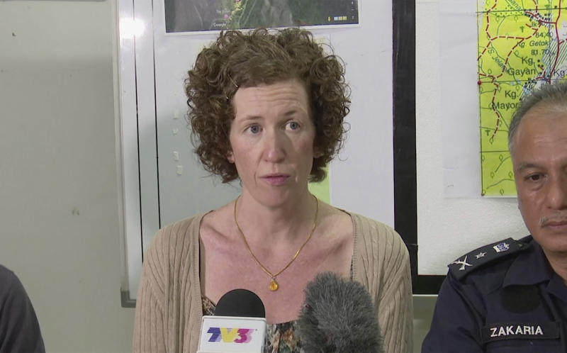 In this image made from a video, Meabh Quoirin, mother of missing schoolgirl Nora Anne Quoirin, reads a statement at a news conference in Seremban, Malaysia Monday, Aug. 12, 2019. A Malaysian shaman joined police from Ireland, France and the U.K. on Monday in the search for the 15-year-old London girl who mysteriously vanished from a nature resort eight days ago, as her parents offered a cash reward and appealed for information. (AP Photo)
