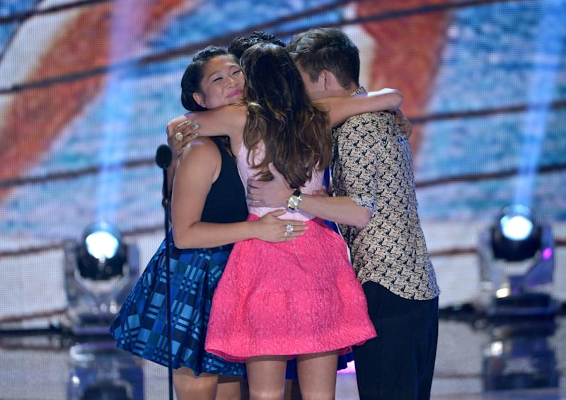"The cast of ""Glee"", from left, Jenna Ushkowitz, Lea Michele and Kevin McHale hug on stage at the Teen Choice Awards at the Gibson Amphitheater on Sunday, Aug. 11, 2013, in Los Angeles. (Photo by John Shearer/Invision/AP)"