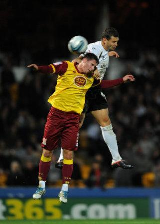 Port Vale's Marc Richards and Northampton Town's Ashley Corker