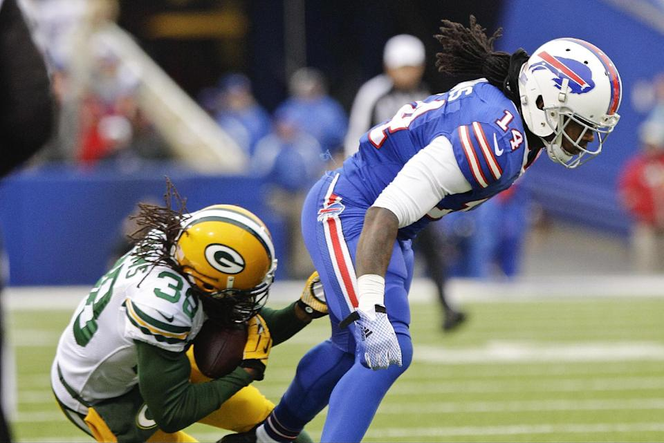 Green Bay Packers' Tramon Williams (38) intercepts a pass to Buffalo Bills wide receiver Sammy Watkins (14) during the first half of an NFL football game Sunday, Dec. 14, 2014, in Orchard Park, N.Y. (AP Photo/Bill Wippert)