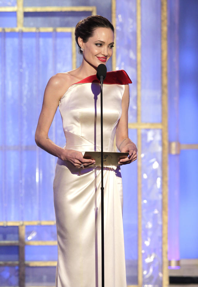 BEVERLY HILLS, CA - JANUARY 15: In this handout photo provided by NBC, actress Angelina Jolie  presents an award onstage during the 69th Annual Golden Globe Awards at the Beverly Hilton International Ballroom on January 15, 2012 in Beverly Hills, California. (Photo by Paul Drinkwater/NBC via Getty Images)