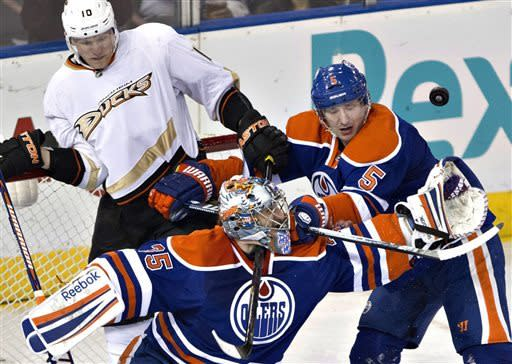 Anaheim Ducks Corey Perry (10) looks for the rebound as Edmonton Oilers goalie Nikolai Khabibulin (35) reaches for the puck and Ladislav Smid (5) defends during second period NHL hockey action in Edmonton, Alberta, on Monday April 22, 2013. (AP Photo/The Canadian Press, Jason Franson)