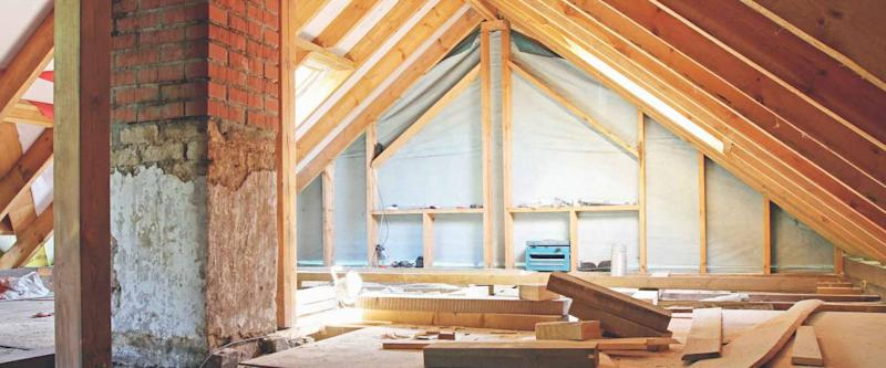an interior view of a house attic under renovation