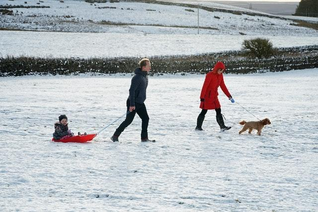 A family take advantage of the Christmas Day snow with a trip out sledging on the hills