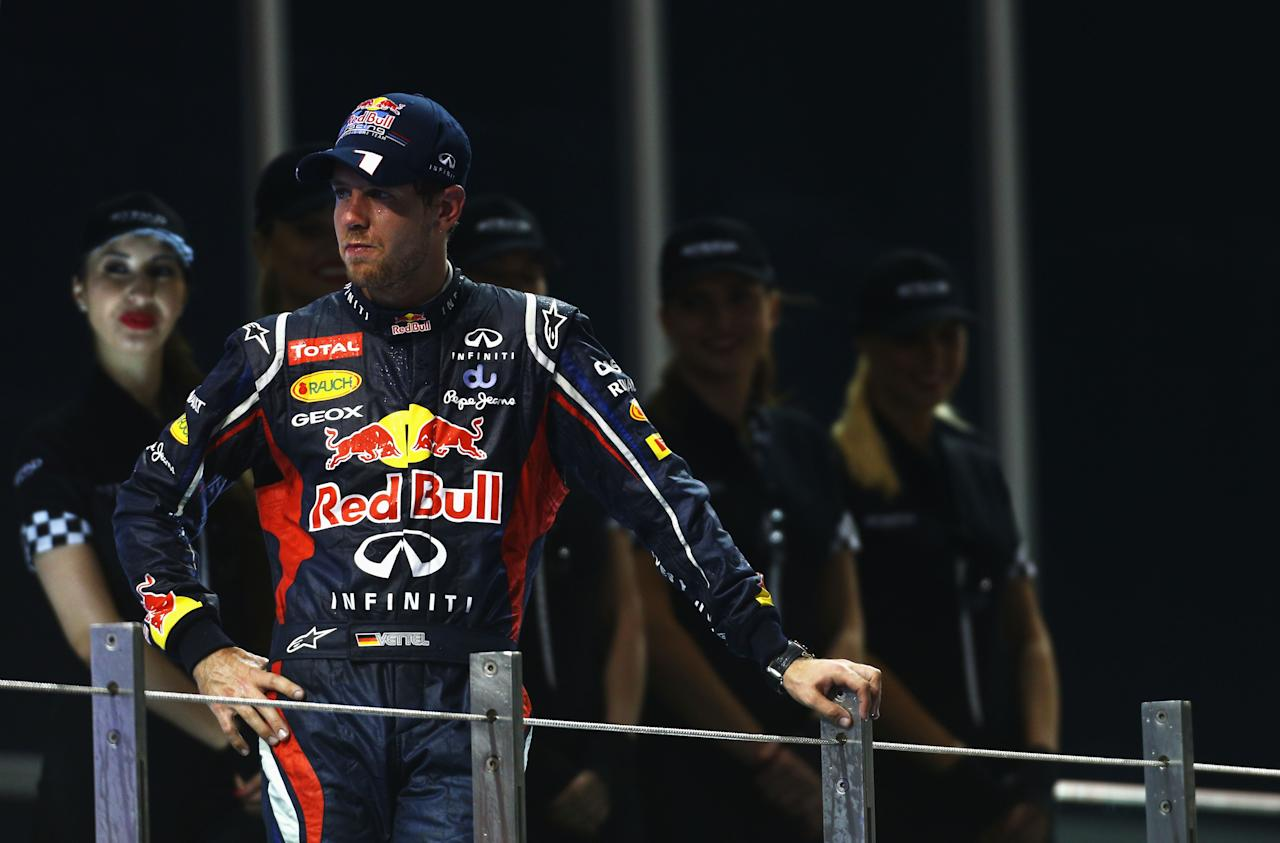 ABU DHABI, UNITED ARAB EMIRATES - NOVEMBER 04:  Sebastian Vettel of Germany and Red Bull Racing celebrates finishing third during the Abu Dhabi Formula One Grand Prix at the Yas Marina Circuit on November 4, 2012 in Abu Dhabi, United Arab Emirates.  (Photo by Paul Gilham/Getty Images)