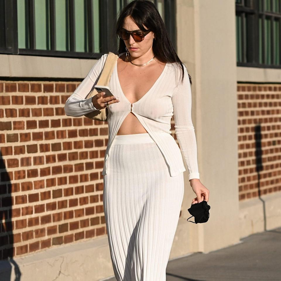 A guest is seen wearing a white top and white skirt outside the Collina Strada show - Daniel Zuchnik / Getty Images North America