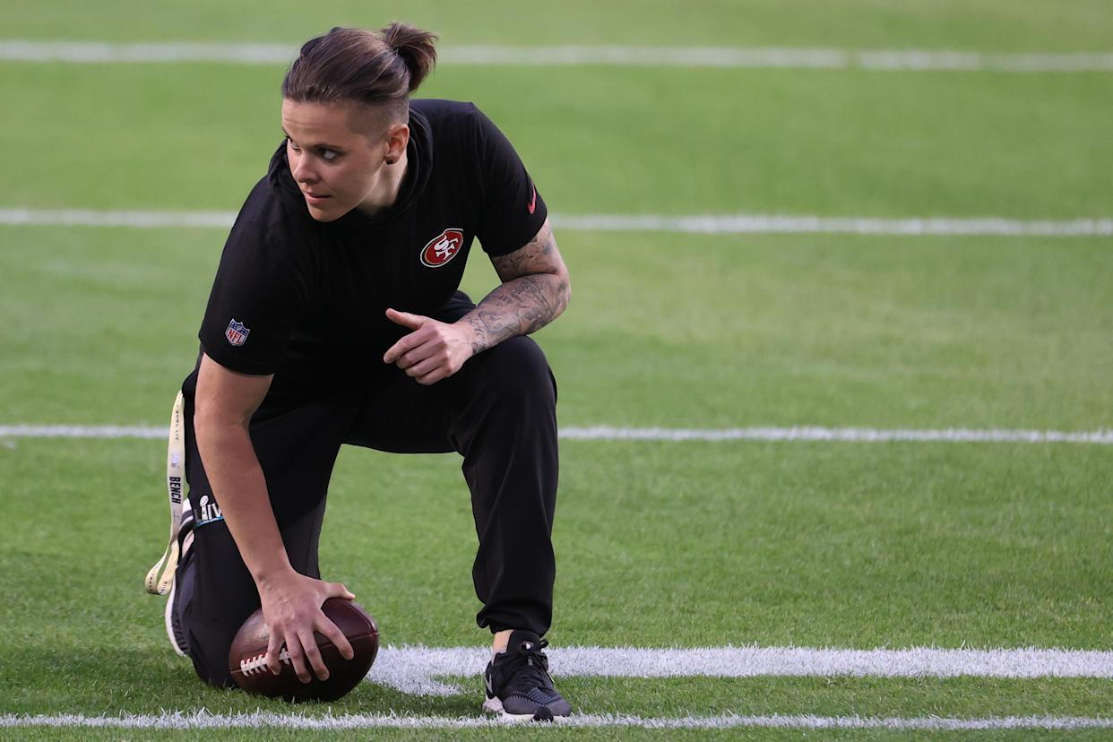 MIAMI, FLORIDA - FEBRUARY 02: Offensive assistant coach Katie Sowers of the San Francisco 49ers looks on during warmups prior to Super Bowl LIV against the Kansas City Chiefs at Hard Rock Stadium on February 02, 2020 in Miami, Florida. (Photo by Al Bello/Getty Images)