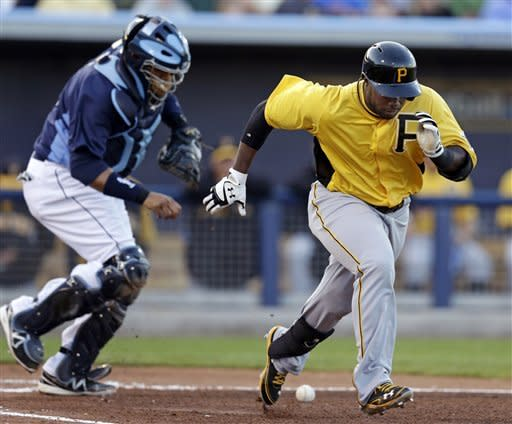 Pittsburgh Pirates' Josh Harrison runs to first as Tampa Bay Rays catcher Jose Molina is able to field the ball and throw him out in the second inning of an exhibition spring training baseball game in Port Charlotte, Fla., Monday, March 25, 2013. (AP Photo/Elise Amendola)