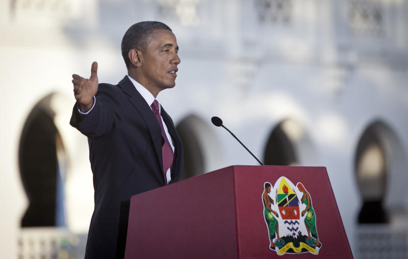 U.S. President Barack Obama speaks at a joint press conference with Tanzanian President Jakaya Kikwete after meeting together at State House in Dar es Salaam, Tanzania Monday, July 1, 2013. Teeming crowds and blaring horns welcomed President Barack Obama to Tanzania's largest city, where the U.S. president's likeness is everywhere as he arrived on the last leg of his three-country tour of the African continent. (AP Photo/Ben Curtis)