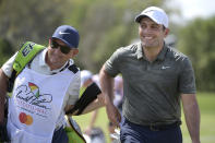 Francesco Molinari, right, of Italy, leaves the first green after making a putt for birdie during the final round of the Arnold Palmer Invitational golf tournament Sunday, March 10, 2019, in Orlando, Fla. (AP Photo/Phelan M. Ebenhack)
