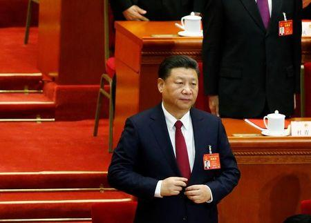 China's President Xi Jinping attends the closing session of China's National People's Congress (NPC) at the Great Hall of the People in Beijing