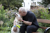 Dave Kent with his guide dog Chad in London, Monday 19, 2019. Dave is reliant on his guide dog to travel and is used to seamlessly crossing borders with Chad, thanks to the EU Pet Passport scheme, but now, as a no-deal Brexit looms for Britain, free pet travel is under threat. (AP Photo/Natasha Livingstone)