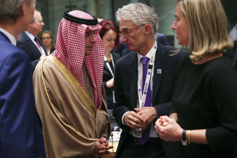 "Saudi Arabia's Foreign Minister Adel Al-Jubeir, left, talks to UN Under-Secretary-General for Humanitarian Affairs Mark Lowcock, centre, and European Union foreign policy chief Federica Mogherini, right, during a Syria donors conference at the European Council headquarters in Brussels, Thursday, March 14, 2019. The European Union's top diplomat says the EU expects ""significant pledges"" for Syria at a donor conference, as the bloc seeks to keep the 8-year conflict in the international spotlight. (AP Photo/Francisco Seco)"