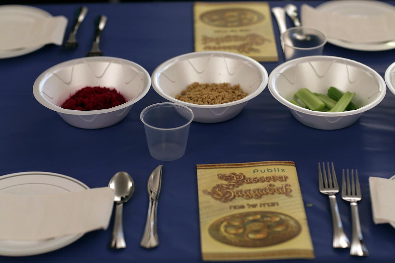 MIAMI BEACH, FL - MARCH 25: A table is set for a  community Passover Seder at Beth Israel synagogue  on March 25, 2013 in Miami Beach, Florida. The community Passover Seder that served around 150 people has been held for the past 30 years and is welcome to anyone in the community that wants to commemorate the emancipation of the Israelites from slavery in ancient Egypt.  (Photo by Joe Raedle/Getty Images)