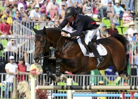 2016 Rio Olympics - Equestrian - Final - Jumping Individual Final Round A + B - Olympic Equestrian Centre - Rio de Janeiro, Brazil - 19/08/2016. Nick Skelton (GBR) of Britain riding Big Star competes. REUTERS/Pilar Olivares