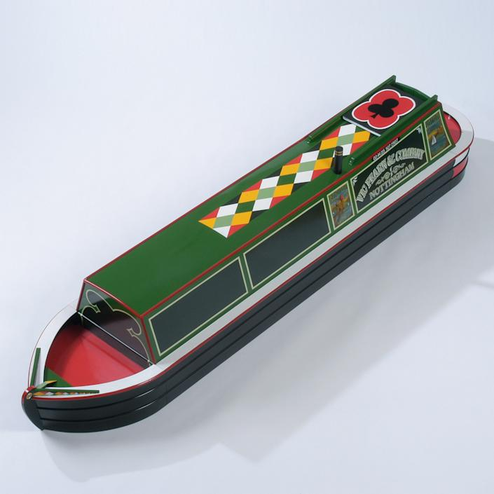 A coffin in the shape of a barge boat. (Photo: Caters News)