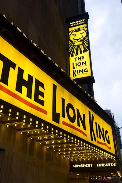 """FILE - In this Jan. 19, 2012 file photo,""""The Lion King"""" marquee is displayed at The Minskoff Theatre in New York. The Lion King"""" has more reason to roar - it's on pace to end the week as the first Broadway show to earn $1 billion. (AP Photo/Charles Sykes, file)"""