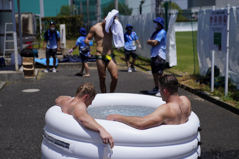 Athletes at the Olympics, like members of the Australian men's rugby team, have had to find creative ways to cool off in Tokyo. (AP Photo/David Goldman)