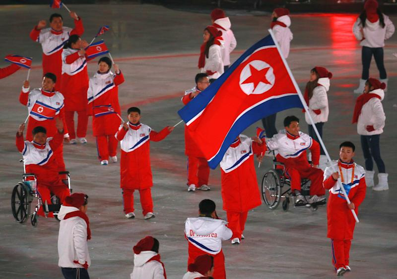 Members of the North Korean national team during the parade of athletes at the Opening Ceremony of the 2018 Winter Paralympic Games at PyeongChang Olympic Stadium