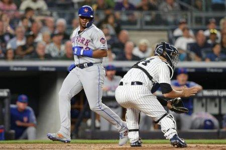 Jul 20, 2018; Bronx, NY, USA; New York Mets designated hitter Yoenis Cespedes (52) scores a run ahead of a tag by New York Yankees catcher Gary Sanchez (24) on a single by left fielder Michael Conforto (not pictured) during the fifth inning at Yankee Stadium. Mandatory Credit: Brad Penner-USA TODAY Sports