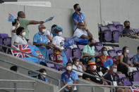 Supporters of Fiji wave flags in the stands during the women's rugby bronze medal match between Fiji and Britain at the 2020 Summer Olympics, Saturday, July 31, 2021 in Tokyo, Japan. (AP Photo/Shuji Kajiyama)