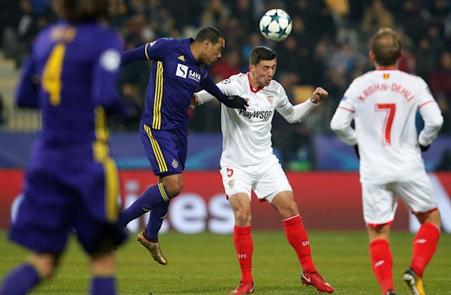 Soccer Football - Champions League - NK Maribor vs Sevilla - Ljudski vrt, Maribor, Slovenia - December 6, 2017 NK Maribor's Marcos Tavares in action with Sevilla's Clement Lenglet REUTERS/Srdjan Zivulovic