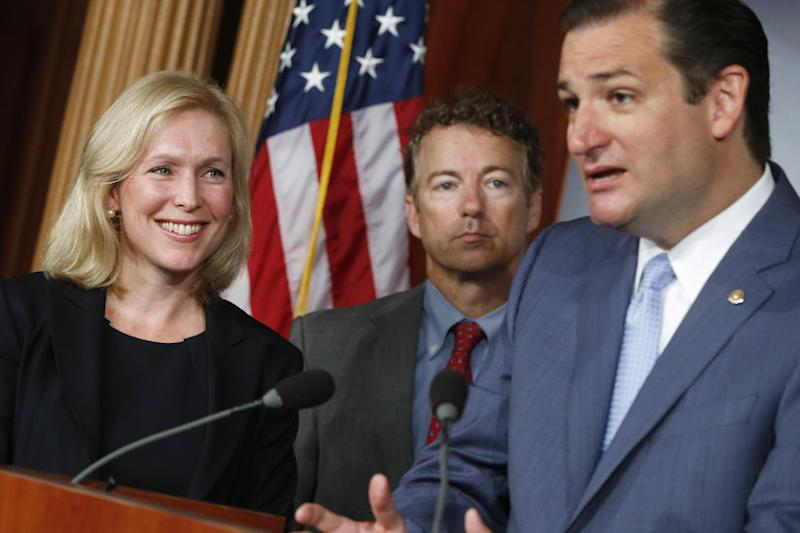 Sen. Kirsten Gillibrand, D-N.Y., left, smiles as she listens to Sen. Ted Cruz, R-Texas speak to reporters during a news conference about a bill regarding military sexual assault cases on Capitol Hill in Washington, Tuesday, July 16, 2013. At center is Sen. Rand Paul, R-Ky. (AP Photo/Charles Dharapak)