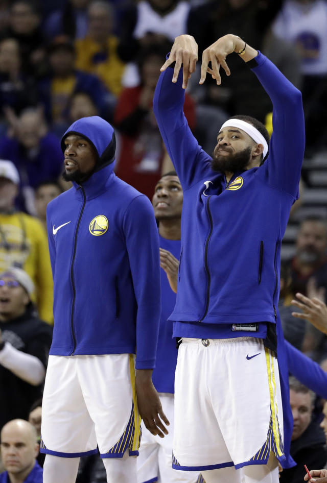 Golden State Warriors' JaVale McGee, right, celebrates after a 3-point basket from teammate Klay Thompson, next to Kevin Durant during the second half of an NBA basketball game against the Dallas Mavericks Thursday, Dec. 14, 2017, in Oakland, Calif. (AP Photo/Marcio Jose Sanchez)