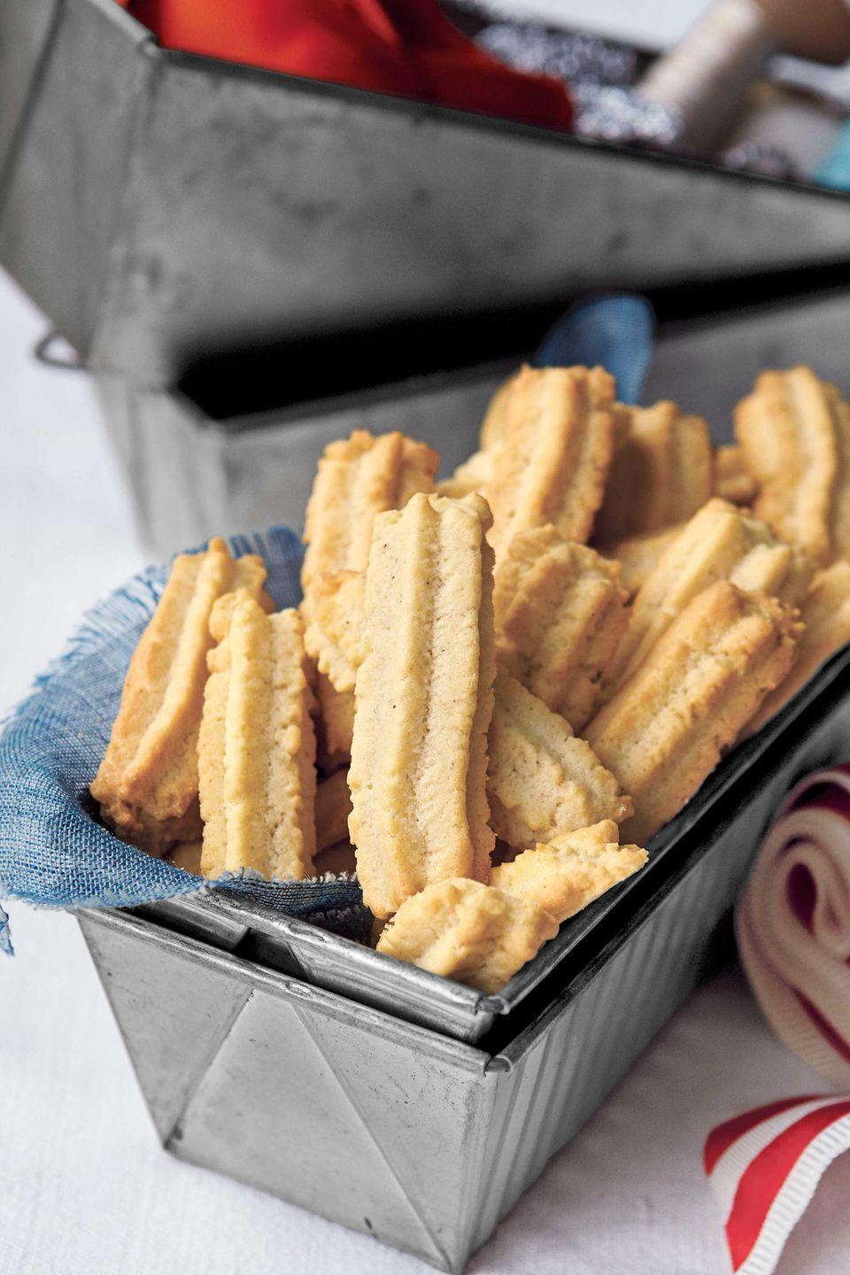 """<p>These simple piped delights contain a secret ingredient: ground cloves! Mild and savory, these cookies taste fantastic with coffee—consider wrapping them up with a bag of roast beans. </p><p><strong><a href=""""https://www.countryliving.com/food-drinks/recipes/a4095/nana-cookies-recipe-clx1211/"""" rel=""""nofollow noopener"""" target=""""_blank"""" data-ylk=""""slk:Get the recipe"""" class=""""link rapid-noclick-resp"""">Get the recipe</a>.</strong></p>"""