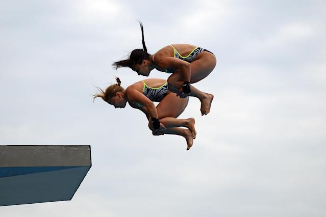SHANGHAI, CHINA - JULY 18: Meaghan Benfeito and Roseline Filion of Canada compete in the Women's 10m Platform Synchro Final during Day Three of the 14th FINA World Championships at the Oriental Sports Center on July 18, 2011 in Shanghai, China. (Photo by Quinn Rooney/Getty Images)