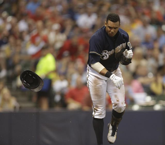 Milwaukee Brewers' Carlos Gomez throws his helmet after striking out during the fifth inning of a baseball game against the St. Louis Cardinals Saturday, July 12, 2014, in Milwaukee. (AP Photo/Jeffrey Phelps)