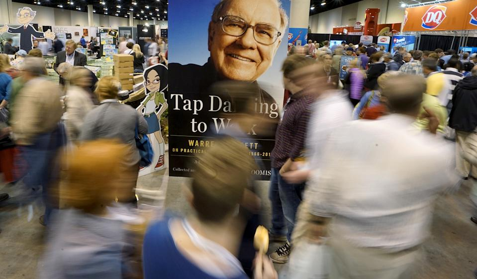 Berkshire Hathaway shareholders walk around the exhibits with a photo of Berkshire CEO Warren Buffett in the center at the Berkshire annual meeting in Omaha, Nebraska May 2, 2015.  REUTERS/Rick Wilking