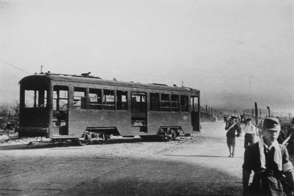 A damaged tram is seen in Hiroshima, western Japan, on Aug. 9, 1945, three days after the first U.S. atomic bomb destroyed the city. (Mitsunobu Kishida/Kyodo News via AP)