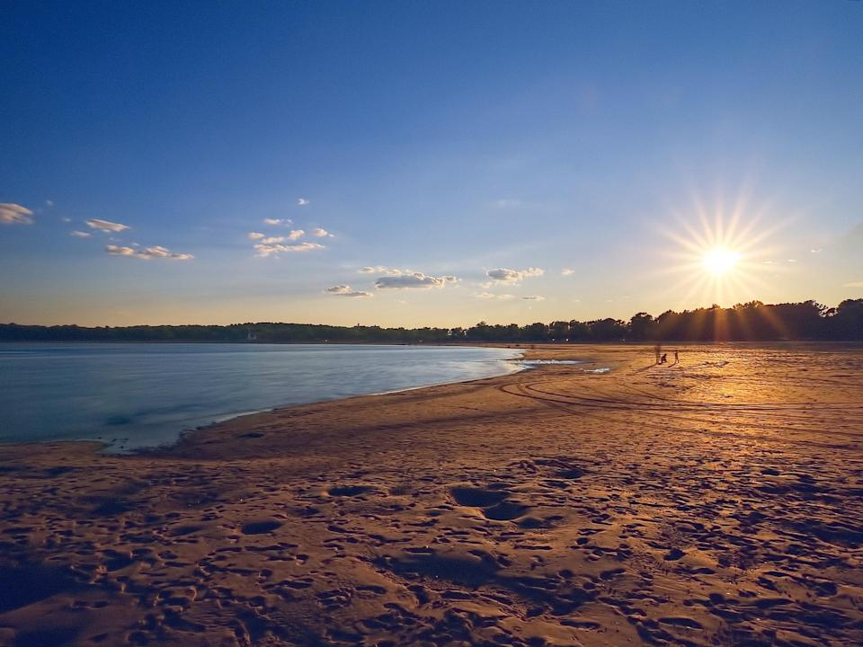 """This mile-long, half–moon slice of Pelham Bay Park is the Bronx's only public beach, and it's a popular spot. Long known as the """"Riviera of New York,"""" it comes with snack bars and picnic areas, two playgrounds, and 26 courts for basketball, volleyball, and handball."""