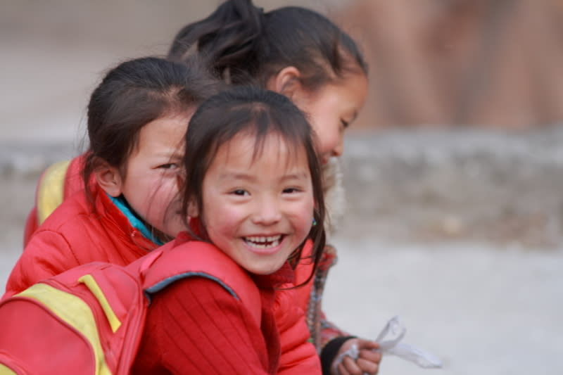Three Baima Zang minority girls going home after school, Chengdu, China. © Ming Zhang/WWF-China