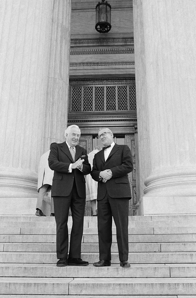 Supreme Court Chief Justice Warren Burger, left, chats with John Paul Stevens on the steps of the court prior to Stevens' swearing-in as its 101st justice in 1975.