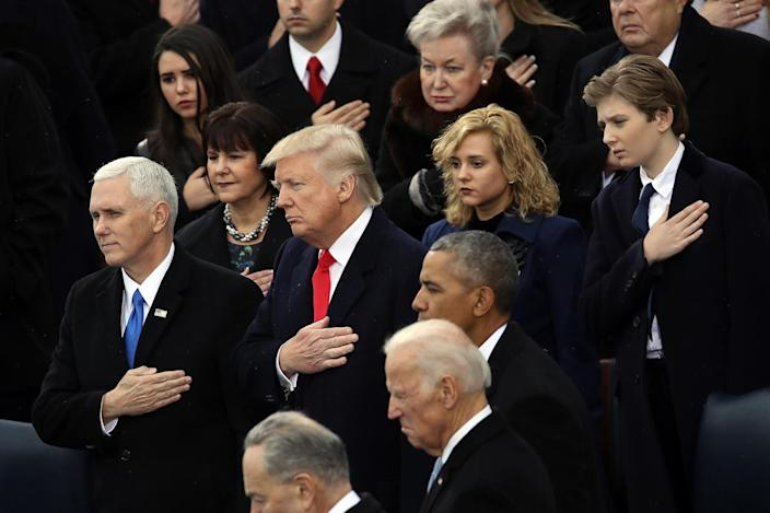 <p>(L-R) Vice President Mike Pence, President Donald Trump, former Vice President Joe Biden, former President Barack Obama and Barron Trump listen to the National Anthem on the West Front of the U.S. Capitol on January 20, 2017 in Washington, DC. (Photo: Drew Angerer/Getty Images) </p>