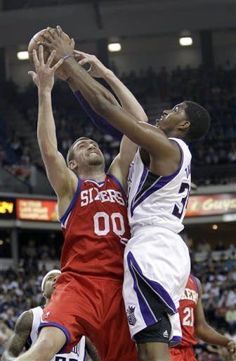 Philadelphia 76ers center Spencer Hawes, left, and Sacramento Kings forward Jason Thompson battle for a rebound during the first quarter of an NBA basketball game in Sacramento, Calif., Sunday, March 24, 2013. (AP Photo/Rich Pedroncelli)