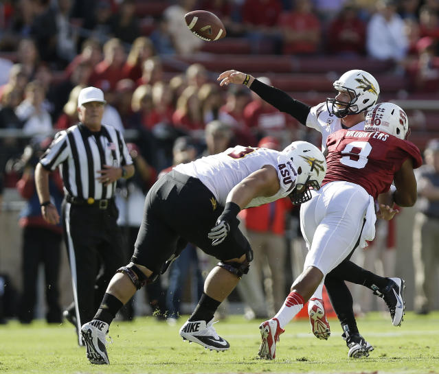 Arizona State quarterback Taylor Kelly, right, throws an interception under pressure from Stanford linebacker James Vaughters (9) during the first half of an NCAA college football game Saturday, Sept. 21, 2013, in Stanford, Calif. (AP Photo/Marcio Jose Sanchez)
