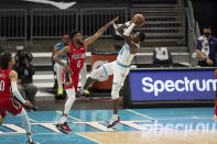 Charlotte Hornets guard Terry Rozier (3) shoots over New Orleans Pelicans guard Nickeil Alexander-Walker (6) during the first half of an NBA basketball game Sunday, May 9, 2021, in Charlotte, N.C. (AP Photo/Brian Westerholt)