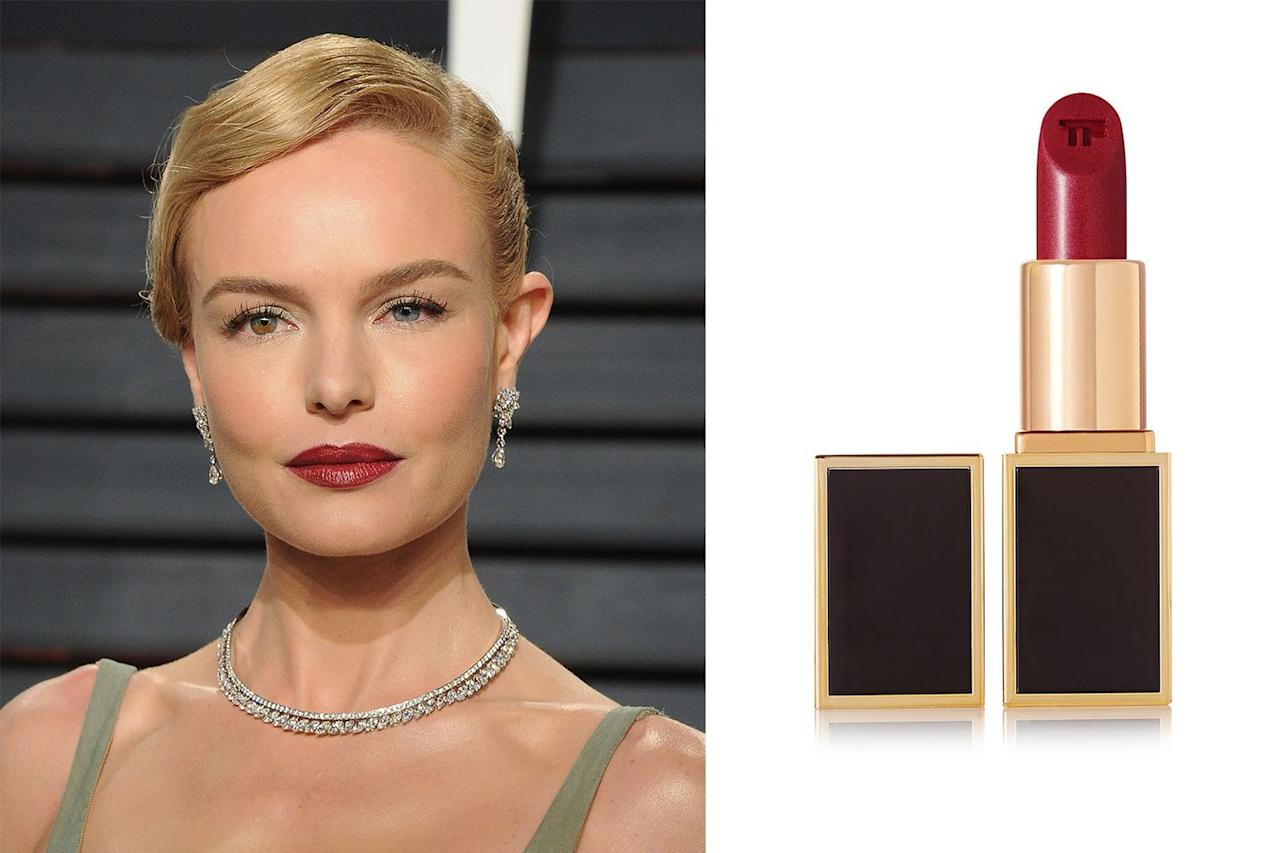 "<p>Calling all blondes! If a super dark matte lipstick feels a little harsh next to your golden locks, try a lighter red take on the berry trend. A satin finish lipstick with a hint of festive gold shimmer makes the look way less intimidating.</p><p><strong>Try...</strong> Tom Ford Lips & Boys in Tony 72 - £28 <a rel=""nofollow"" href=""https://www.net-a-porter.com/gb/en/product/686885"">SHOP</a></p>"