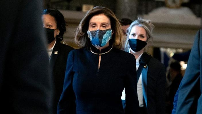 Speaker of the House Nancy Pelosi (center) walks to the House Floor during a vote on the impeachment of President Donald Trump at the U.S. Capitol Wednesday. (Photo by Stefani Reynolds/Getty Images)