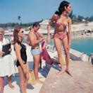<p>Martine Beswick (pink bikini), Sean Connery (blue trunks) and Claudine Auger (black suit) on set of Thunderball.</p>