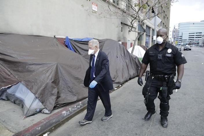 LOS ANGELES, CA - APRIL 03: U.S. District Court judge David O. Carter tours skid row with LAPD officer Deon Joseph on Friday, April 3, 2020 in Los Angeles, CA. Carter is the judge at the center of the Orange County riverbed homeless case. (Myung J. Chun / Los Angeles Times)