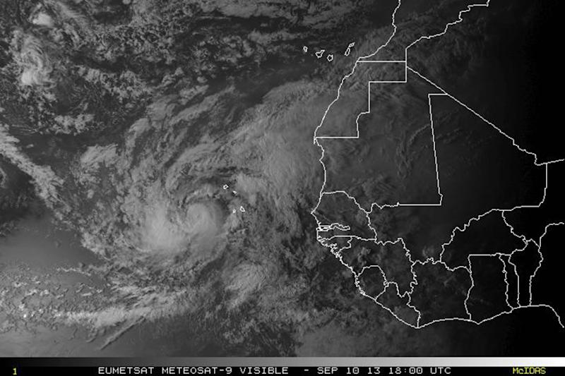This satellite image made available by NOAA shows Tropical Storm Humberto off the coast of west Africa on Tuesday, Sept. 10, 2013. In the U.S., summer is almost over, and as of Tuesday morning, Sept. 10, 2013, not a single hurricane had formed this year. Tornado activity in 2013 is also down around record low levels, while heat waves are fewer and milder than last year, according to the National Oceanic and Atmospheric Administration. If Humberto stays a tropical storm through 8 a.m. EDT Wednesday, Sept. 11, 2013, it will be the latest date for the first hurricane of the season since satellites started watching the seas in 1967, according to the National Hurricane Center. (AP Photo/NOAA)