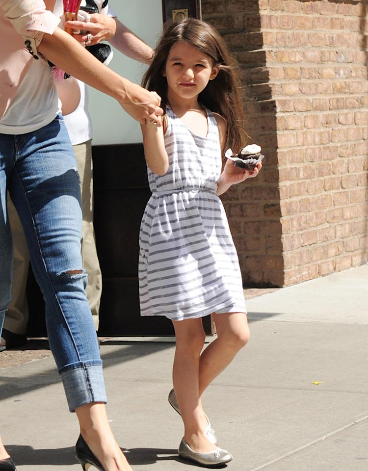 Katie Holmes and Suri Cruise step out  of their downtown hotel in Manhattan. Suri keeps a tight grip on her cupcake. Pictured: Katie Holmes and Suri Cruise  Ref: SPL405810  140612  Picture by: A. Ariani / Splash News   Splash News and Pictures Los Angeles:310-821-2666 New York:212-619-2666 London:870-934-2666 photodesk@splashnews.com