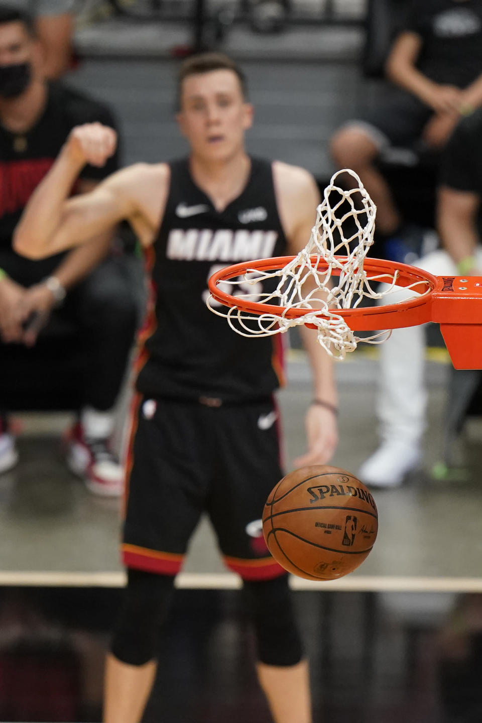 Miami Heat forward Duncan Robinson, rear, reacts as his three-point shot goes in during the second half of an NBA basketball game against the Dallas Mavericks, Tuesday, May 4, 2021, in Miami. (AP Photo/Wilfredo Lee)