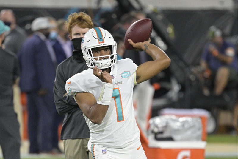 Miami Dolphins quarterback Tua Tagovailoa warms up before an NFL football game against the Miami Dolphins, Thursday, Sept. 24, 2020, in Jacksonville, Fla. (AP Photo/Phelan M. Ebenhack)