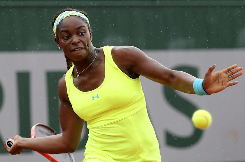Sloane Stephens, of the U.S, returns the ball to compatriot Vania King during their second round match of the French Open tennis tournament at the Roland Garros stadium Thursday, May 30, 2013 in Paris. (AP Photo/Michel Euler)